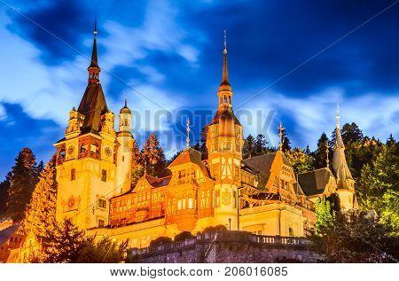 Sinaia Romania. Idyllic landscape with Peles Castle built by Kings of Romania and Carpathian Mountains.