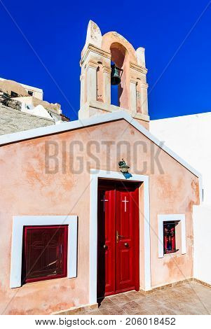 Santorini Greece. Small colored church detail in Oia city in Thira Greek Islands in Aegean Sea greek landmark.