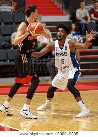 ST. PETERSBURG, RUSSIA - AUGUST 6, 2017: Alexey Shved, Russia and Shawn Dawson, Israel in action during basketball match Russia (black) vs Israel (white) during Kondrashin-Belov Cup. Israel won 79-71