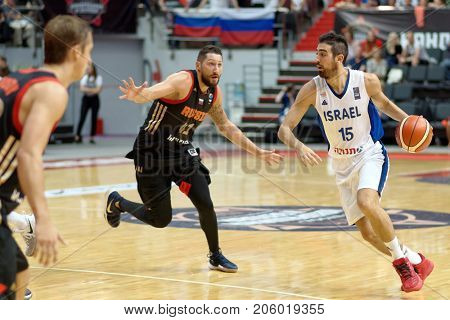 ST. PETERSBURG, RUSSIA - AUGUST 6, 2017: Bar Timor, Israel and Nikita Kurbanov, Russia in action during basketball match Russia (black) vs Israel (white) for Kondrashin-Belov Cup. Israel won 79-71