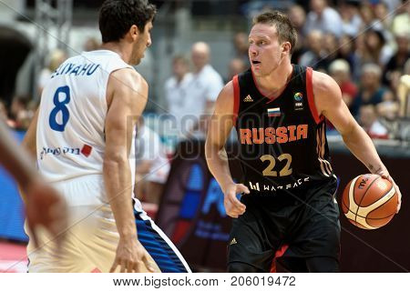 ST. PETERSBURG, RUSSIA - AUGUST 6, 2017: Dmitry Kulagin, Russia and Lior Eliyahu, Israel in action during basketball match Russia (black) vs Israel (white) for Kondrashin-Belov Cup. Israel won 79-71
