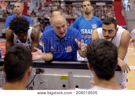 ST. PETERSBURG, RUSSIA - AUGUST 6, 2017: Israel national basketball team coach Erez Edelstein gives instructions to the players in the basketball match against Russia during Kondrashin-Belov Cup