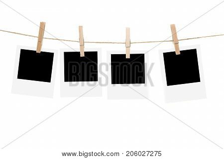 Clothesline with empty picture frames and clothespins isolated on a white background