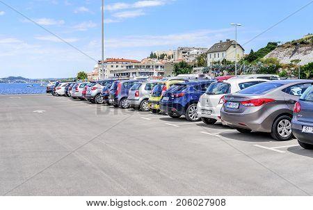 SIBENIK, CROATIA - 14 JULY, 2017 Parking cars in the port