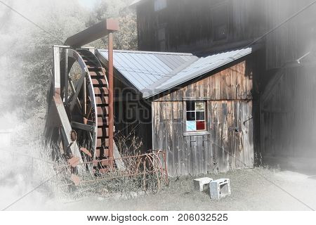 Old grist mill in rural Vermont with fade effect