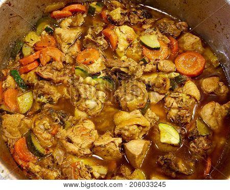 chicken stew in a restaurant big pan