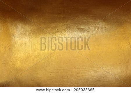 Smooth golden wall with glossy finish for background.