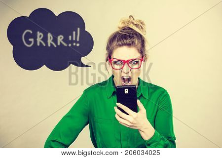 Angry Business Woman Looking At Phone, Thinking Bubble