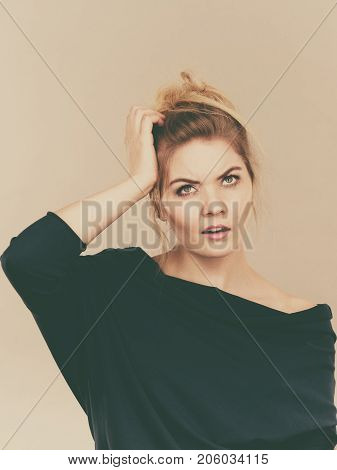 Confused Young Blonde Woman Thinking