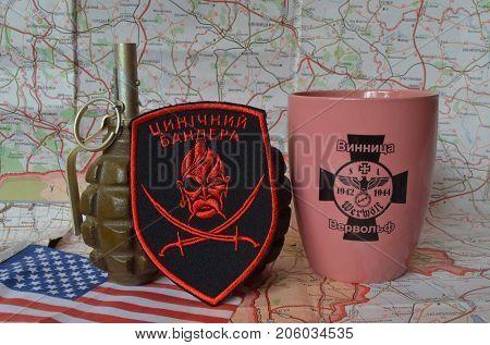 ILLUSTRATIVE EDITORIAL.Chevron of Ukrainian nazionalist battalion.Souvenir mug with German nazi symbols.Incription -  VIINITSA-WERVOLF (UKR). Kiev,Ukraine.September 11, 2017