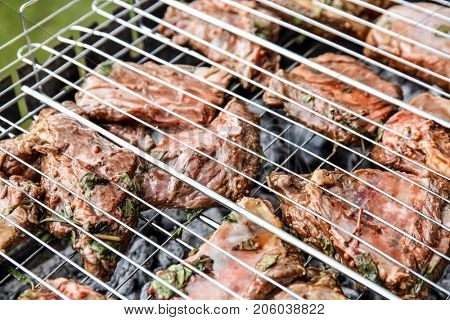 Cooking of appetizing juicy spare ribs outdoors