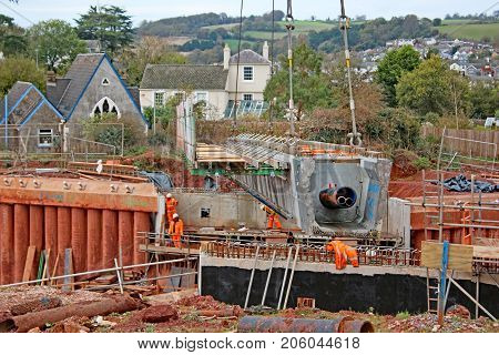crane laying concrete bridge beams of new road
