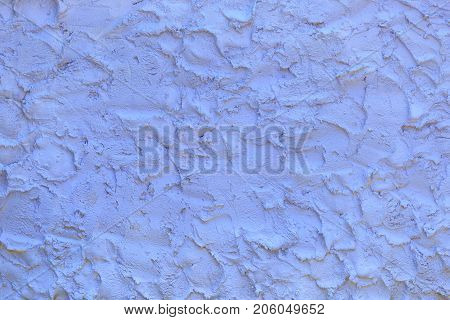 Violet surface made of the rough brushworks of plaster as a background