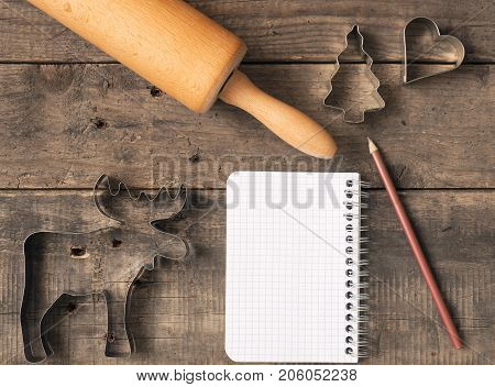 Christmas bakery background baking tin and rolling pin on an old wooden table
