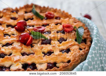Tasty cherry pie on table, closeup