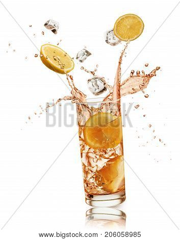 glass full of orange drink with orange slices and ice cubes falling and splashing on white background