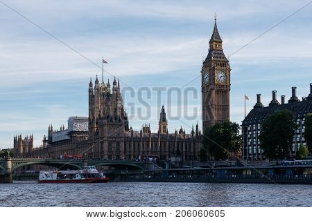 LONDON, UK - MAY 21, 2017: View of London's sights, Big Ben and Houses of Parliament, from River Thames. London is one of the most visited cities in the world.