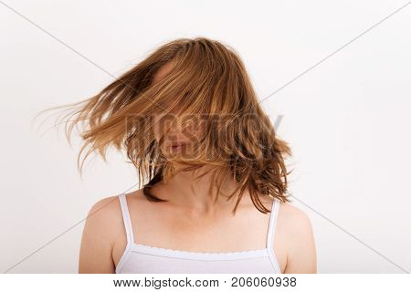 Wellness and spa. Sensual woman model with windswept flying blond hair on white background.