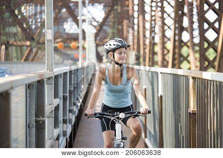 A Young Woman Riding Bike outside having fun
