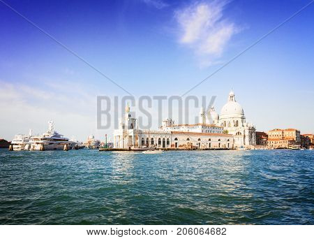 view of Basilica Santa Maria della Salute and Dogana, old custom house, old town of Venice, Italy, retro toned