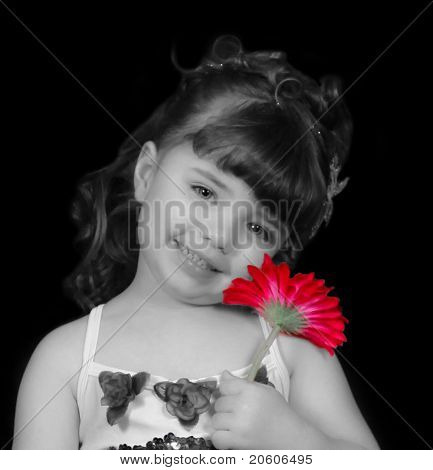 Adorable Little Girl In Ballet Outfit In Black And White Holding A Brightly Colored Daisy Close To H