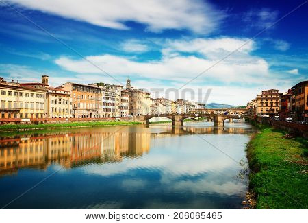 old town, bridges and river Arno reflecting in water at summer day, Florence, Italy, retro toned poster