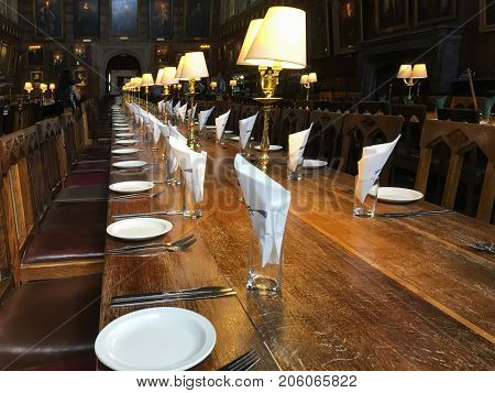 OXFORD, UK - MAY 22, 2017: Dinner tables ready at The Great Hall of Christ Church, University of Oxford. It has been used as a prototype for the Hall at Harry Potter's Hogwarts school.