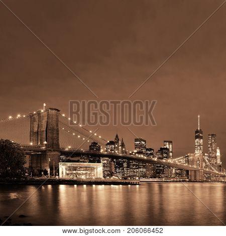 Manhattan Downtown urban view with Brooklyn bridge at night