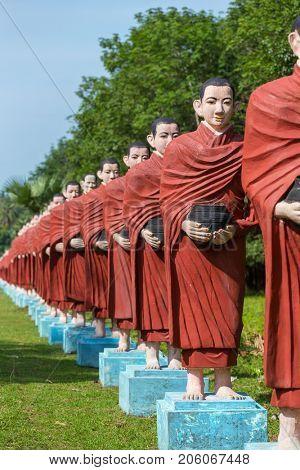 Statues of Buddhist monks at the Win Sein Taw Ya Buddha in Kyauktalon Taung, near Mawlamyine, Myanmar.