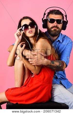 Relax And Music Concept. Man With Beard Hugs Pretty Girl