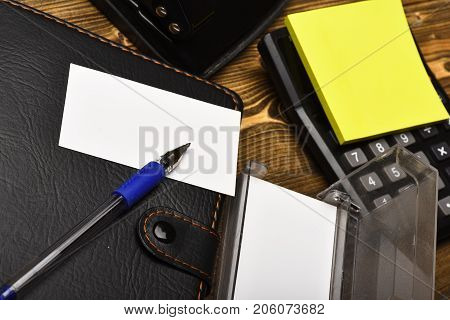 Calculator, Hole Punch, Business Card Holder And Organizer, Close Up