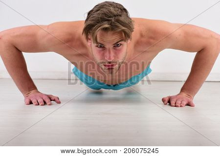 Athlete With Concentrated Face On White Background.