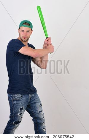Player With Concentrated Face Plays Baseball. Sports And Baseball Training