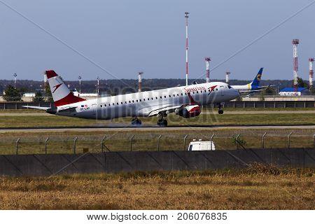 Borispol, Ukraine - September 26, 2017: Austrian Airlines Embraer ERJ-195LR aircraft landing on the runway to Borispol International Airport on September 26, 2017. Editorial use only