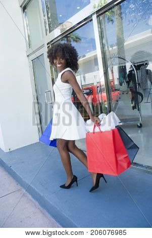 Young fashionable girl on a shopping spree