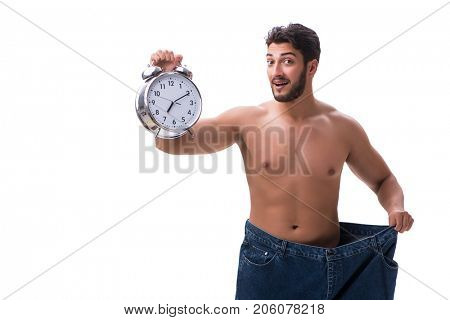 Man in dieting concept with oversized jeans