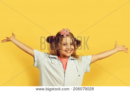 Girl With Happy Smiling Face Isolated On Warm Yellow Background