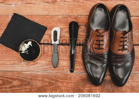 leather shoes with shoe maintenance set.Shoes care.copy space.top view