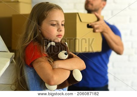 Kid And Guy Move In Or Out. Daughter Hugs Bear