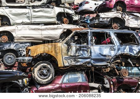 Indianapolis - Circa September 2017: Stacked junk yard clunker cars prepared for crushing to be recycled XI