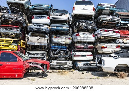 Indianapolis - Circa September 2017: Stacked junk yard clunker cars prepared for crushing to be recycled XIII