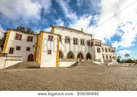 Exterior facade of National Palace of Sintra also called Town Palace, in Portuguese Palacio Nacional de Sintra, in urban center of Sintra, Lisbon District, Portugal. Unesco Heritage Site.