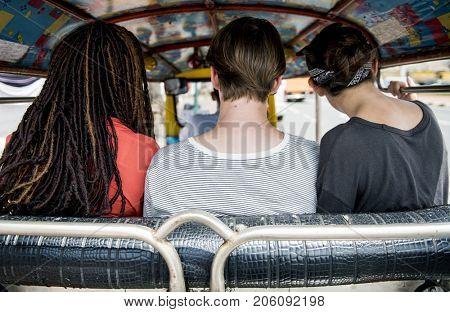 Group of tourists enjoy tuk tuk native taxi drive