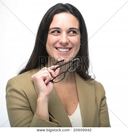 happy pretty business woman holding glasses looking up into the corner