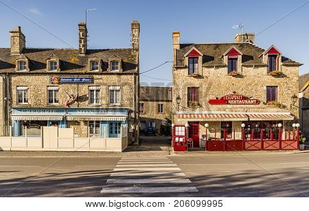 SAINTE MARIE DU MONT - APRIL 5: street and old Building on April 5 2015 in Sainte Marie du Mont Manche Normandy France