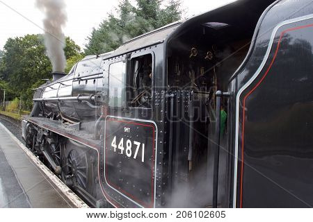 The Jacobite Steam train ready for departure for Mallaig over the Glenfinnan Viaduct made popular by a certain wizard