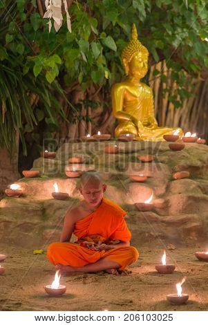 Chiang Mai, Thailand - November 14, 2016: Buddhist monk meditate in Phan Tao Temple during Yi Peng festival in Chiang Mai, Thailand.