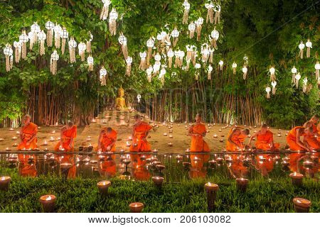 Chiang Mai, Thailand - November 14, 2016: Yi Peng Festival, Buddhist monk fire candles to the Buddha and floating lamp on in Phan Tao Temple, Chiangmai, Thailand.