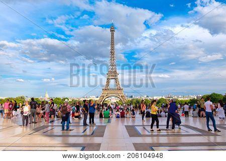 PARIS,FRANCE - JULY 30,2017 : The Tour Eiffel and tourists at the Palace de Chaillot in Paris