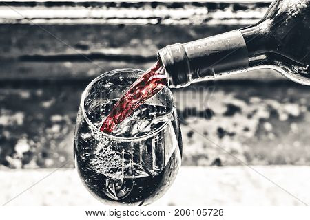 Pouring Wine Red Wine In A Glass.